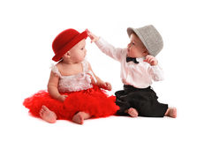 Girl red skirt hat and  boy hat, love, Valentine's Day Stock Photo