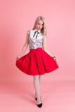 Girl in a red skirt. Portrait of slim girl in a red skirt Stock Photos