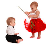 Girl red skirt rose and  boy gentleman, love, Valentine's Day Stock Photos