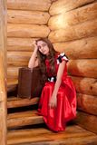 Girl in red spanish dress sitting on stairs Stock Images