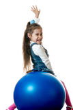Girl on red sphere Royalty Free Stock Photo