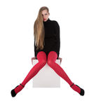 The girl in red stockings Stock Images
