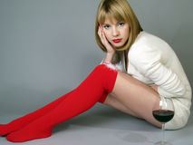 Girl in red stockings and a white jacket Stock Image
