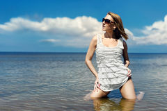 Girl in a red suit at the beach Stock Image