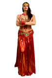 Girl in a red suit oriental dance Stock Images