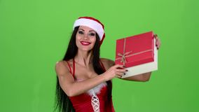 Girl in a new year costume holds a gift in her hand. Green screen stock video footage