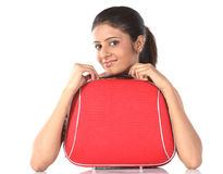 Girl with red suitcase Royalty Free Stock Image