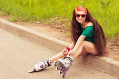 Girl in red sunglasses sitting and resting on a sunny day Royalty Free Stock Photo