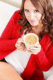 Girl red sweater holds mug with coffee Royalty Free Stock Photography