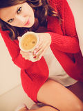 Girl red sweater holds mug with coffee Royalty Free Stock Images