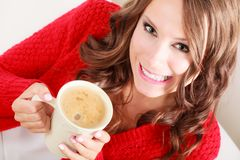 Girl red sweater holds mug with coffee Royalty Free Stock Image