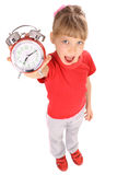 Girl in red t-shirt and alarm clock. Stock Photography