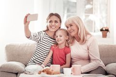 Girl in a red t-shirt feeling nice with her family stock photos