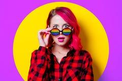 Girl in red tartan shirt and sunglasses stock photos
