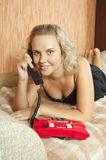 Girl with red telephone Stock Image