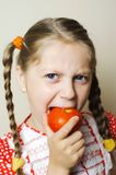 Girl with red tomato Stock Photo