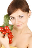 Girl with red tomatoes Royalty Free Stock Photos