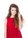 Girl in red touching hair Stock Photography