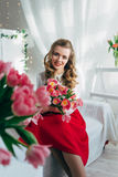 Girl with red tulips Royalty Free Stock Images