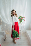 Girl with red tulips Royalty Free Stock Image