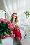 Girl with red tulips Stock Photo