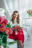 Girl with red tulips Royalty Free Stock Photo