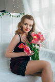 Girl with red tulips Royalty Free Stock Photography
