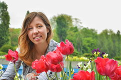 Girl with red tulips Stock Photos
