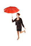 Girl with red umbrella. Stock Image