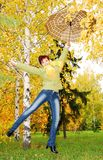 Girl and red umbrella in the autumn park. Stock Images