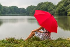 Girl with red umbrella Royalty Free Stock Image