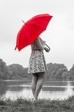 Girl with red umbrella Stock Photography