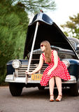 Girl in red with vintage car Stock Images