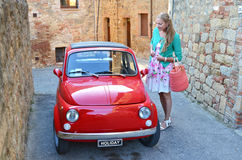 Girl and a red vintage car. On the narrow Italian street royalty free stock photography