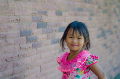 Girl red wall Royalty Free Stock Image