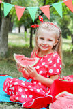 Girl in red with watermelon on picnic Royalty Free Stock Photography