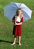 Girl in red with white umbrella. Barefoot little girl in red dress standing with a white umbrella royalty free stock photos