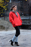 Girl in a red windbreaker Stock Photography