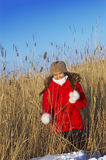 Girl in a red winter jacket Royalty Free Stock Image