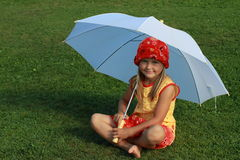 Girl in red and yellow dress with white umbrella. Barefoot little girl in red and yellow dress sitting with a white umbrella stock images