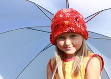 Girl in red and yellow with white umbrella. Little girl in red and yellow dress sitting with a white umbrella stock photos