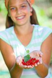 Girl with redcurrant. Royalty Free Stock Photos