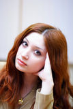 Girl with reddish hair in office Stock Photos