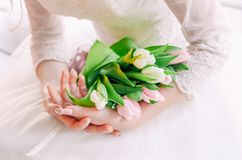 Hi spring tulip flowers bouquet hands woman stock images