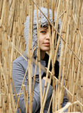 Girl in reed. The girl a look through the reed Royalty Free Stock Images