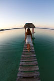 A girl refelecting on a tranquil lake Stock Photo