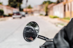 Girl reflected on motorbike mirror 3 Stock Photos