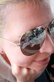 Girl is reflected in the sunglasses of mother Stock Image