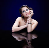 Girl at reflecting table Royalty Free Stock Photo