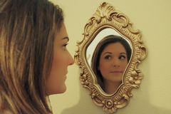 Girl reflection in mirror Stock Photography